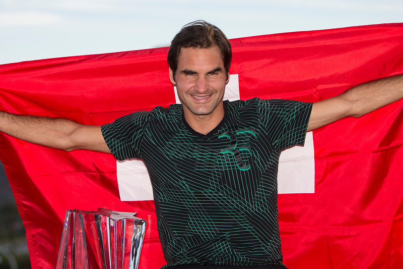 March 19, 2017: Roger Federer, SUI, poses with the Swiss flag after defeating Stan Wawrinka, SUI, 6-4,7-5 in the finals at the PNB Paribas Open being played at the Indian Wells Tennis Garden in Indian Wells, California.  ©Mal Taam/Tennisclix