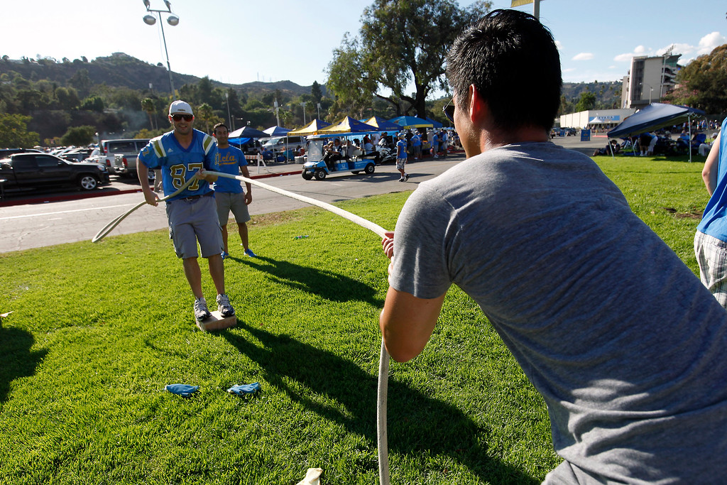 . Tug-of-war before the UCLA-Nevada game at the Rose Bowl, Saturday, August 31, 2013. (Michael Owen Baker/L.A. Daily News)
