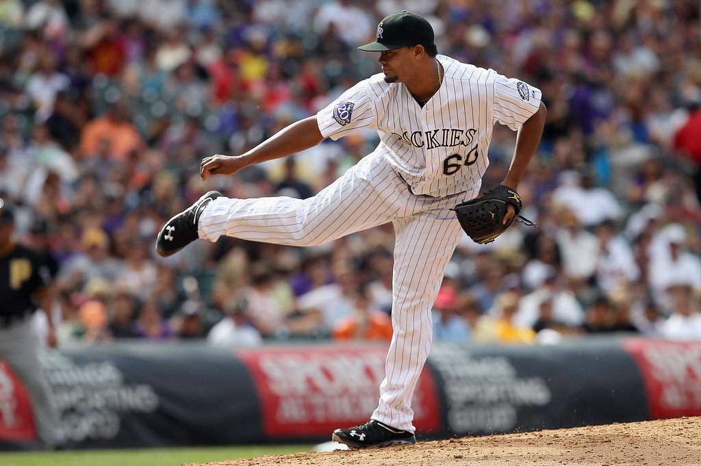 . Relief pitcher Manny Corpas #60 of the Colorado Rockies works against the Pittsburgh Pirates in the seventh inning at Coors Field on August 11, 2013 in Denver, Colorado. Corpas earned the win as the Rockies defeated the Pirates 3-2.  (Photo by Doug Pensinger/Getty Images)