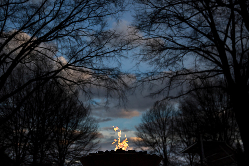 . An eternal flame burns at the gravesite of Rev. Martin Luther King Jr., Monday, Jan. 16, 2017, in Atlanta. (AP Photo/Branden Camp)