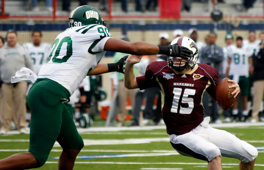 . Ohio defensive lineman Tremayne Scott (90) reaches for Louisiana Monroe quarterback Kolton Browning (15) as he sacks him during the second quarter of the Independence Bowl NCAA college football game in Shreveport, La., Friday, Dec. 28, 2012. (AP Photo/Rogelio V. Solis)