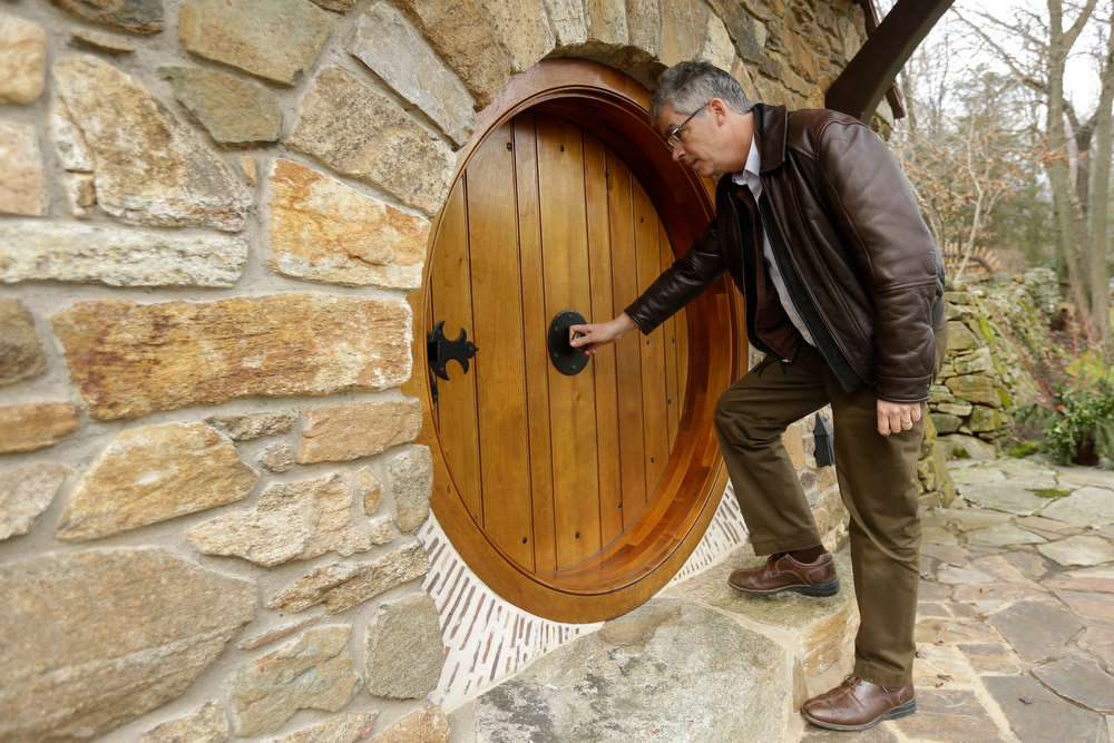 . Architect Peter Archer enters the ìHobbit Houseî during and interview with the Associated Press Tuesday, Dec. 11, 2012, in Chester County, near Philadelphia.  Archer has designed a ìHobbit Houseî containing a world-class collection of J.R.R. Tolkien manuscripts and memorabilia. (AP Photo/Matt Rourke)