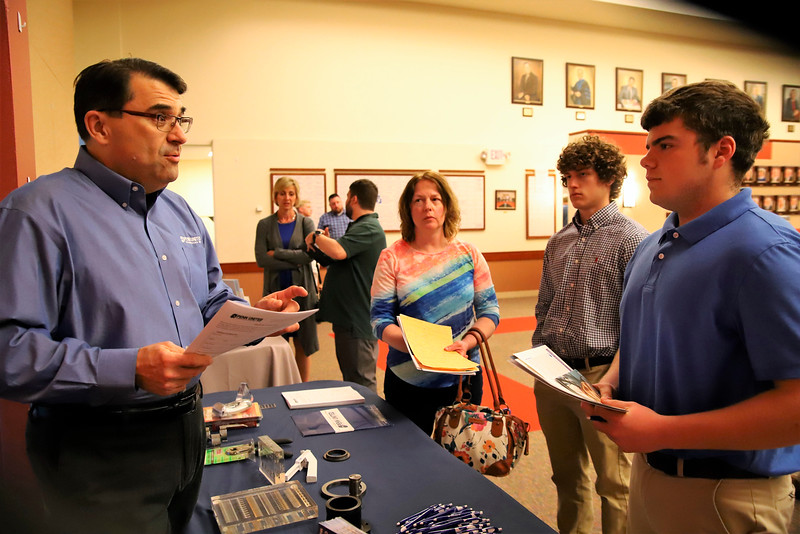 Penn United Technologies Inc. HR manager Jim McKain discusses pre-apprenticeship opportunities with Lenape Tech junior Glenn Spath, 16, of Freeport Wednesday night at the Apprenticeship Summit at Butler County Community College 04/17/19.