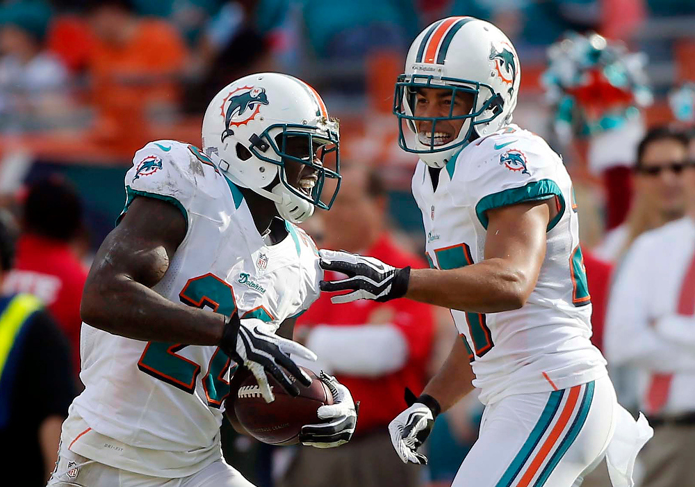 . Miami Dolphins cornerback Jimmy Wilson, right, congratulates  free safety Reshad Jones (20) after Jones intercepted a ball thrown by Buffalo Bills quarterback Ryan Fitzpatrick during the second half of an NFL football game on Sunday, Dec. 23, 2012, in Miami. (AP Photo/John Bazemore)