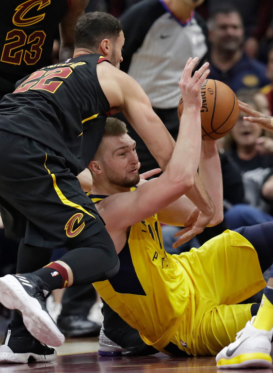 . Indiana Pacers\' Domantas Sabonis (11), from Lithuania, tries to pass the ball against Cleveland Cavaliers\' Larry Nance Jr. (22) in the first half of Game 1 of an NBA basketball first-round playoff series, Sunday, April 15, 2018, in Cleveland. (AP Photo/Tony Dejak)