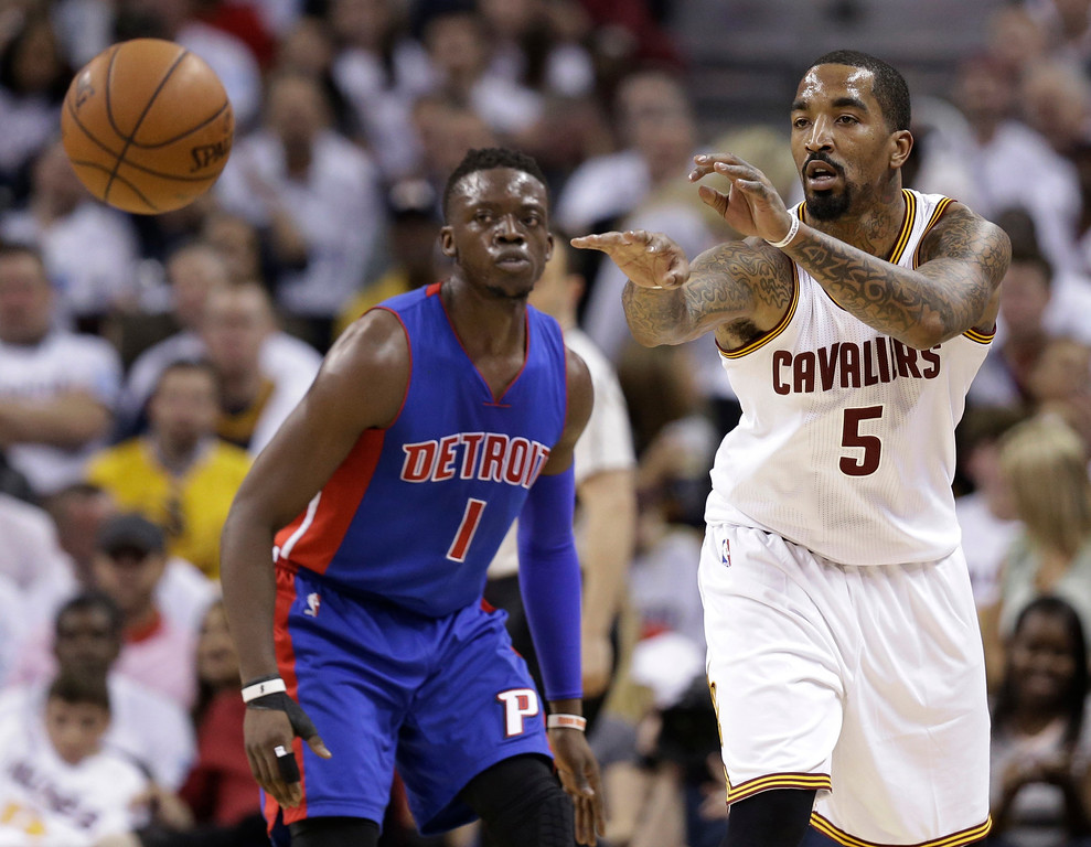. Cleveland Cavaliers\' J.R. Smith (5) passes against Detroit Pistons\' Reggie Jackson during the second half in Game 2 of a first-round NBA basketball playoff series, Wednesday, April 20, 2016, in Cleveland. The Cavaliers won 107-90. (AP Photo/Tony Dejak)