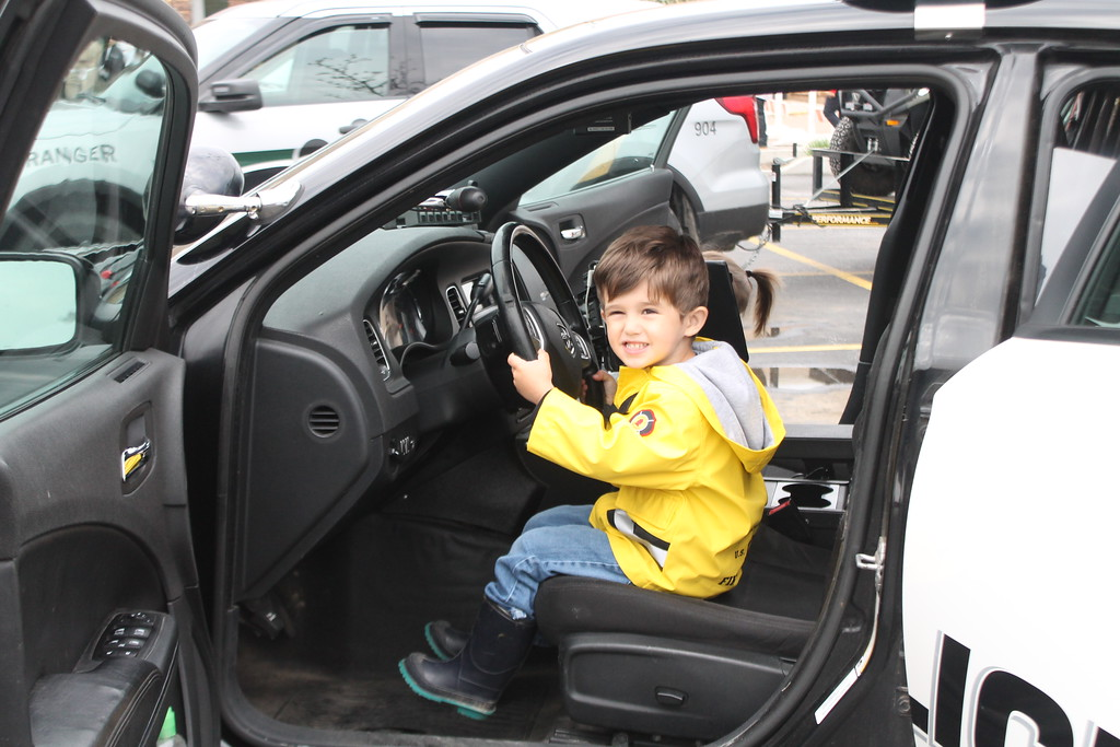 . Kristi Garabrandt � The News-Herald <br> Mikie Chongris, 3, Eastlake sits in a police cruiser from the Eastlake Police Department  during the 36th Annual Heroes Day held at Great Lakes Mall, May 12, 2018.