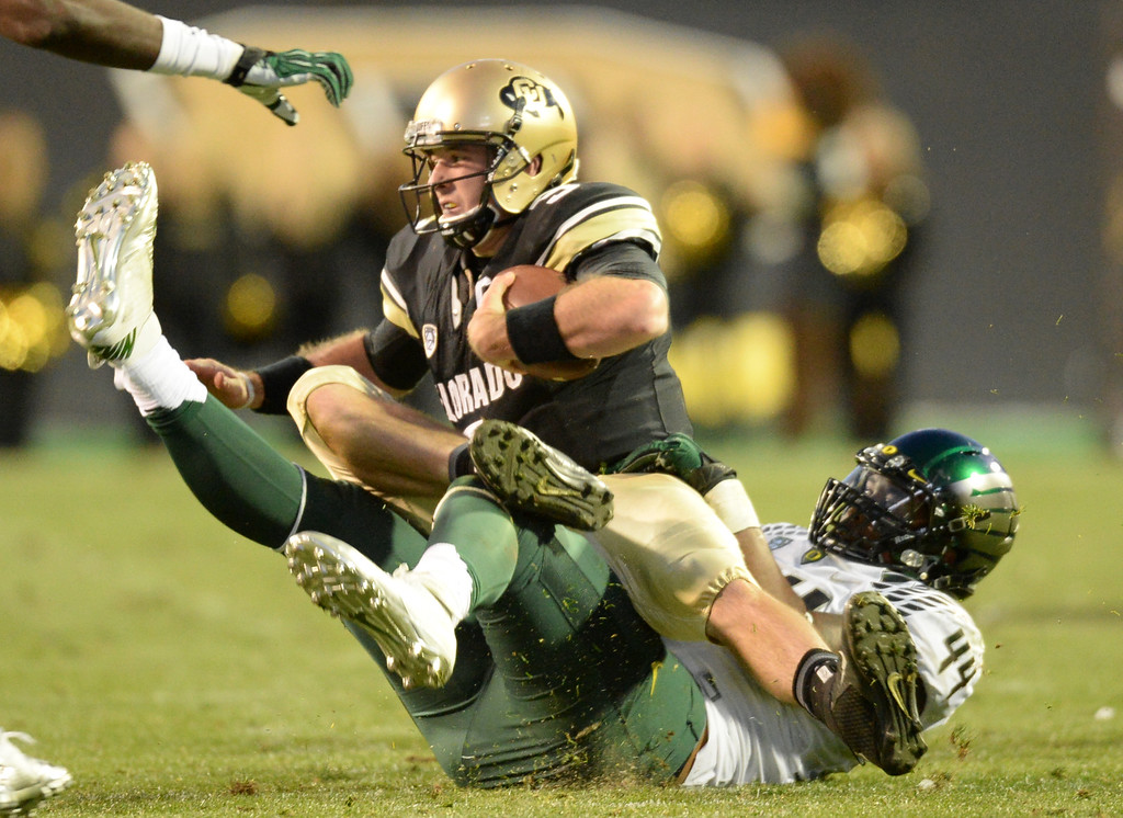 . QB Connor Wood of University of Colorado (5) sacked by DeForest Buckner of University of Oregon (44) in the 4th quarter of the game at Folsom Field. Boulder, Colorado. October 5, 2013. Oregon won 57-16. (Photo by Hyoung Chang/The Denver Post)