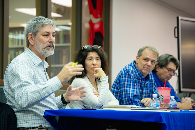 Dr. Philippe Tissot (left) speaks as part of a panel during the 100 Years After the Storm presentation.