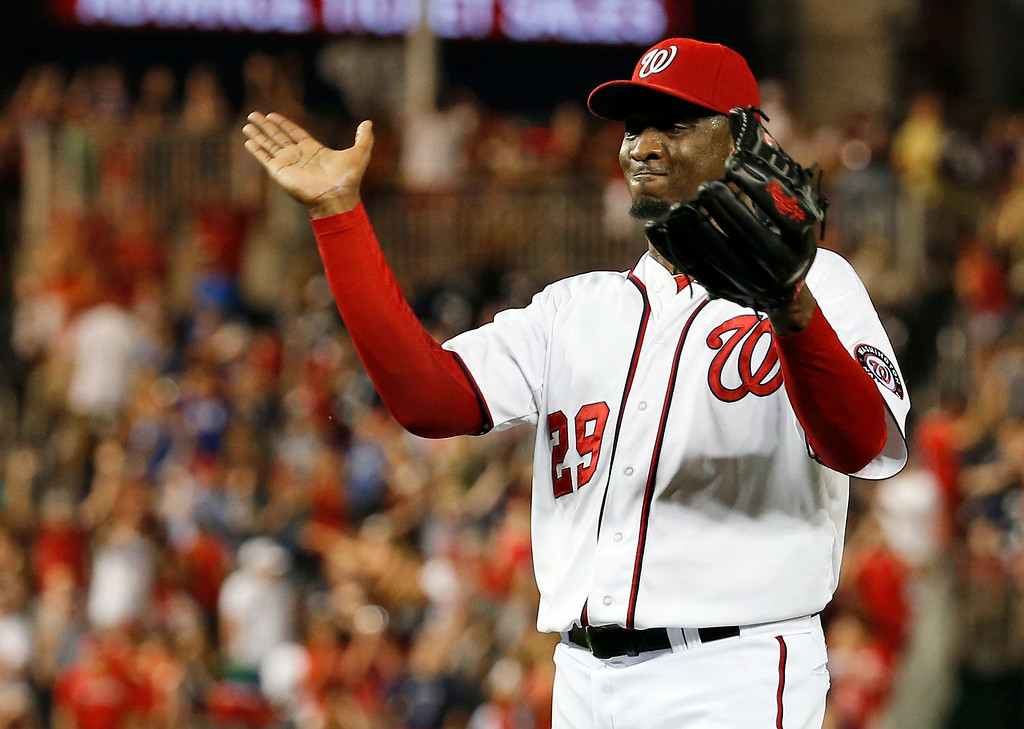 . Washington Nationals relief pitcher Rafael Soriano celebrates after the last out of a baseball game against the Colorado Rockies at Nationals Park, Wednesday, July 2, 2014, in Washington. The Nationals won 4-3, and swept the three-game series with the Rockies. (AP Photo/Alex Brandon)