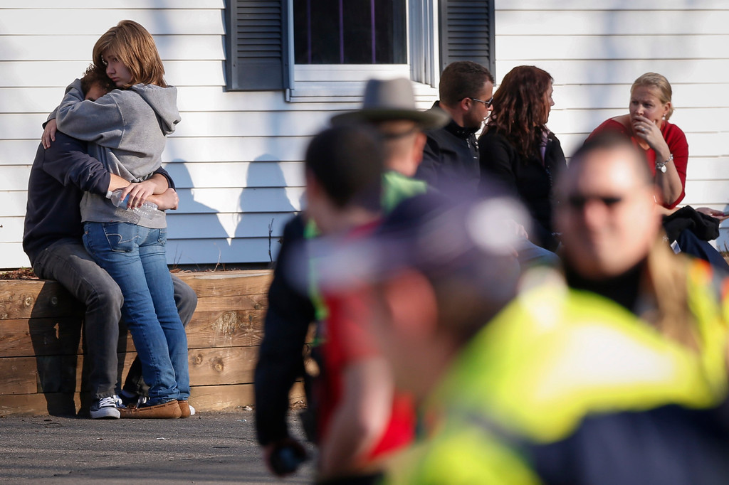 . A couple embrace each other near Sandy Hook Elementary School, where a gunman opened fire on school children and staff in Newtown, Connecticut on December 14, 2012. A heavily armed gunman opened fire on school children and staff at a Connecticut elementary school on Friday, killing at least 26 people, including 18 children, in the latest in a series of shooting rampages that have tormented the United States this year.     REUTERS/Adrees Latif