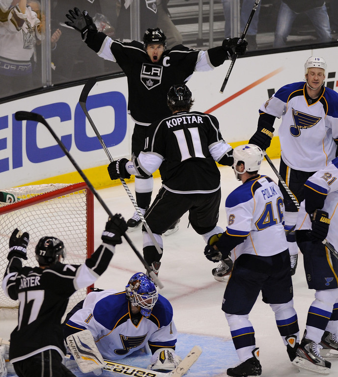 . The Kings\' Anze Kopitar (#11) celebrates with Dustin Brown after scoring against the St. Louis Blues in the third period. (Michael Owen Baker/Staff Photographer)