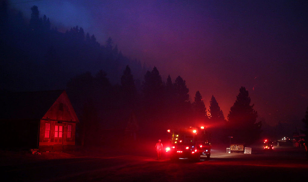 . In this Monday night Aug. 12, 2013 photo, firefighters start a back burn along the Pine-Featherville Road while battling the more than 90,000-acre Elk Fire Complex near Pine, Idaho.  (AP Photo/The Times-News, Ashley Smith)
