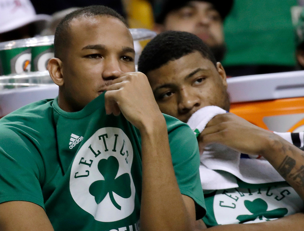 . Boston Celtics guards Avery Bradley, left, and Marcus Smart watch from the bench during the second half of Game 2 of the NBA basketball Eastern Conference finals against the Cleveland Cavaliers, Friday, May 19, 2017, in Boston. (AP Photo/Elise Amendola)