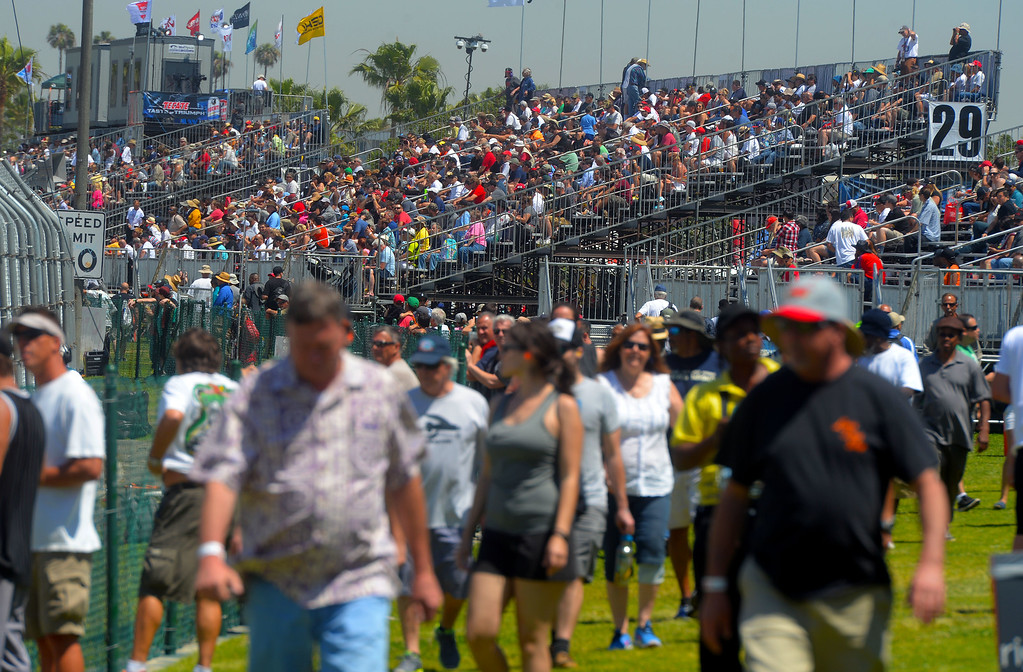 . Fans watch the Indy cars practice in Long Beach, CA on Friday, April 17, 2015. The 40th annual Toyota Grand Prix of Long Beach kicked off with practices for all of the racing divisions. (Photo by Scott Varley, Daily Breeze)