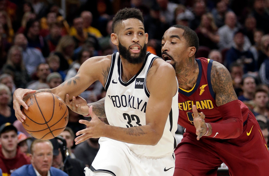 . Brooklyn Nets\' Allen Crabbe (33) drives past Cleveland Cavaliers\' JR Smith (5) during the first half of an NBA basketball game, Wednesday, Nov. 22, 2017, in Cleveland. (AP Photo/Tony Dejak)