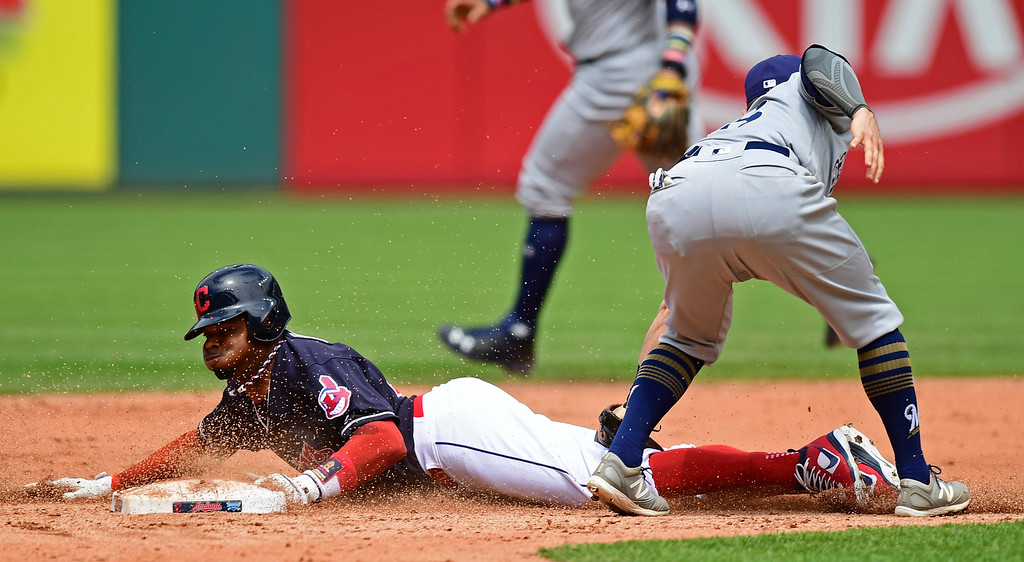 . Cleveland Indians\' Rajai Davis steals second base as Milwaukee Brewers\' Eric Sogard is late on the tag in the fifth inning of a baseball game, Wednesday, June 6, 2018, in Cleveland. (AP Photo/David Dermer)