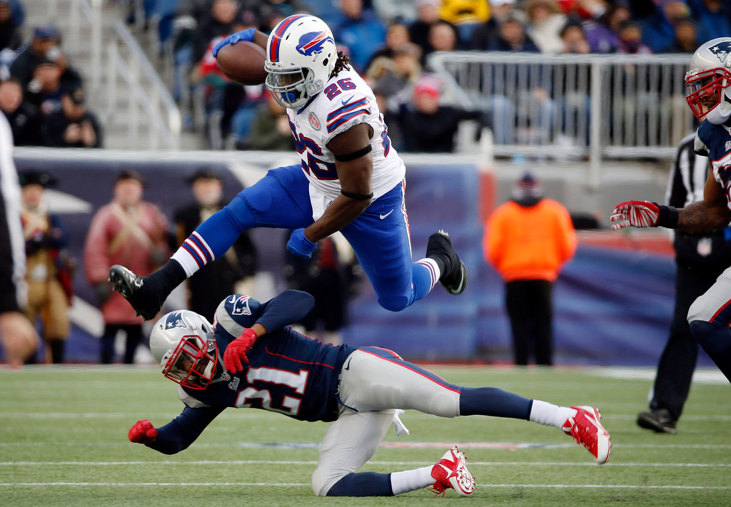. New England Patriots defensive back Malcolm Butler (21) tackles Buffalo Bills running back Anthony Dixon (26) in the second half of an NFL football game Sunday, Dec. 28, 2014, in Foxborough, Mass. (AP Photo/Elise Amendola)