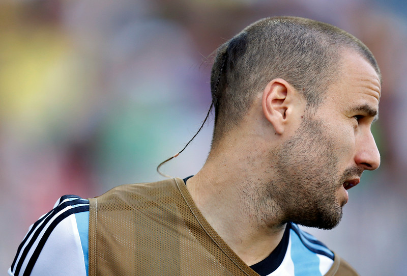 . Argentina\'s Rodrigo Palacio warms-up on the touchline during the World Cup round of 16 soccer match between Argentina and Switzerland at the Itaquerao Stadium in Sao Paulo, Brazil, Tuesday, July 1, 2014. (AP Photo/Frank Augstein)
