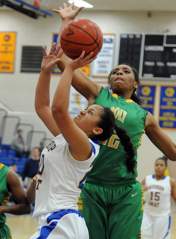 . Long Beach Poly\'s Jada Matthews (22) blocks the shot of Bishop Amat\'s Janae Chamois in the first half of a CIF State Southern California Regional semifinal basketball game at Bishop Amat High School on Tuesday, March 12, 2013 in La Puente, Calif. Long Beach Poly won 52-34.  (Keith Birmingham Pasadena Star-News)