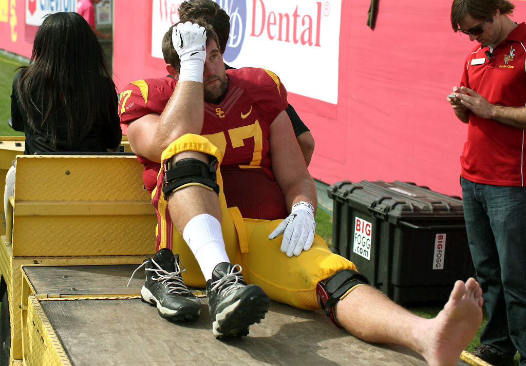 . USC\'s Kevin Graf is carted off the field with an injury in the first half, Saturday, October 26, 2013, at the L.A. Memorial Coliseum. (Michael Owen Baker/L.A. Daily News)