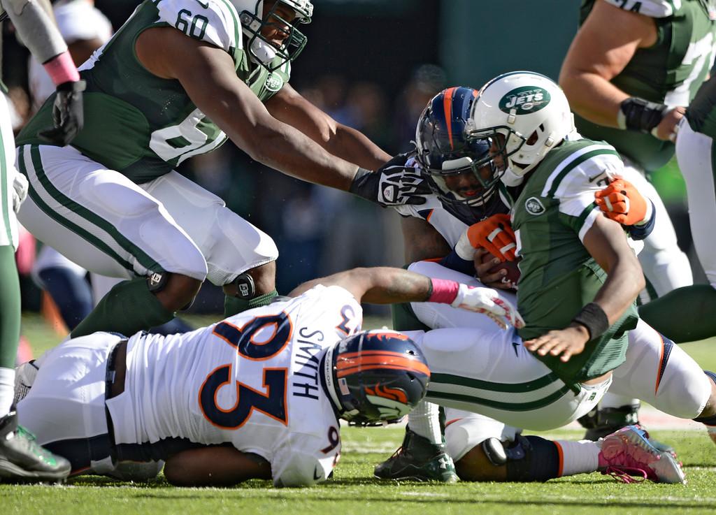 . Denver Broncos outside linebacker Von Miller (58) and Denver Broncos defensive end Quanterus Smith (93) sack New York Jets quarterback Geno Smith (7) during the third quarter  October 12, 2014 at Metlife Stadium. (Photo by John Leyba/The Denver Post)