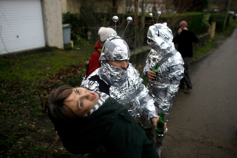 . A man in an alien costume made of tin foil jokes with a local woman in the town of Bugarach, France, Friday, Dec. 21, 2012. Although the long expected end of the Mayan calendar has come, the New Age enthusiasts have steered clear from the sleepy French town of Bugarach, which gave some locals a chance to joke about the UFO legends that surround the area. (AP Photo/Marko Drobnjakovic)