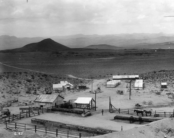 . A view of early excavation for building the L.A. Aqueduct to Owens Valley, done between 1907 and 1913. Here we have one of the construction workers camps which was located along the aqueduct route near Big Pine.   (Los Angeles Public Library)