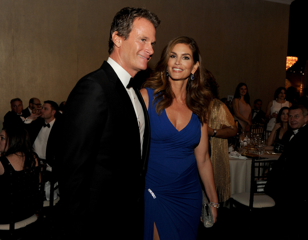 . Model Cindy Crawford (R) and businessman Rande Gerber attend the 72nd Annual Golden Globe Awards cocktail party at The Beverly Hilton Hotel on January 11, 2015 in Beverly Hills, California.  (Photo by Kevin Winter/Getty Images)