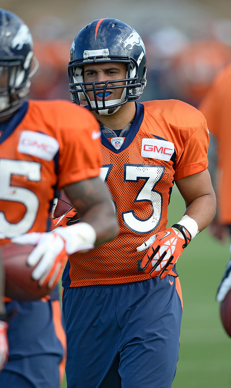 . Denver Broncos running back Jerodis Williams (33) runs through drills on day 12 of the Denver Broncos 2014 training camp August 5, 2014 at Dove Valley. (Photo by John Leyba/The Denver Post)