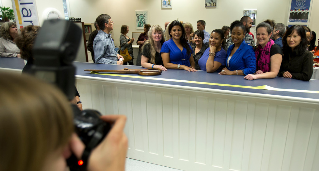 . City employees pose for a photograph at the service counter of the newly remodeled Permit Center inside City Hall, Wednesday, Nov. 6, 2013 in Alameda, Calif. (D. Ross Cameron/Bay Area News Group)