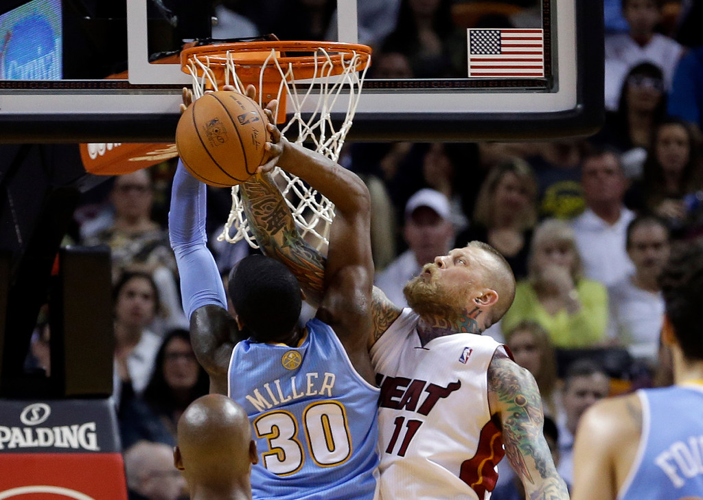 . Miami Heat forward Chris Andersen (11) blocks a shot by Denver Nuggets forward Quincy Miller (30) during the first half of an NBA basketball game in Miami, Friday, March 14, 2014. (AP Photo/Alan Diaz)