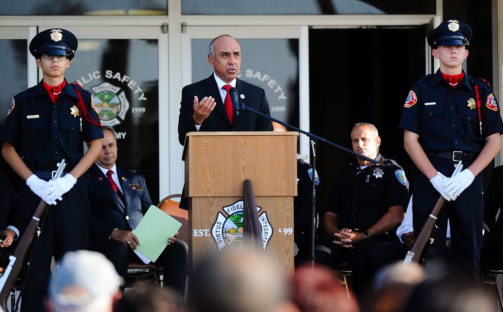 . San Bernardino County District Attorney Michael Ramos speaks during a 9/11 remembrance ceremony at the Public Safety Academy in San Bernardino on Wednesday, Sept. 11, 2013. San Bernardino City Mayor Patrick Morris, San Bernardino County Supervisor James Ramos and other dignitaries spoke during the event. (Photo by Rachel Luna / San Bernardino Sun)(Photo by Rachel Luna / San Bernardino Sun)