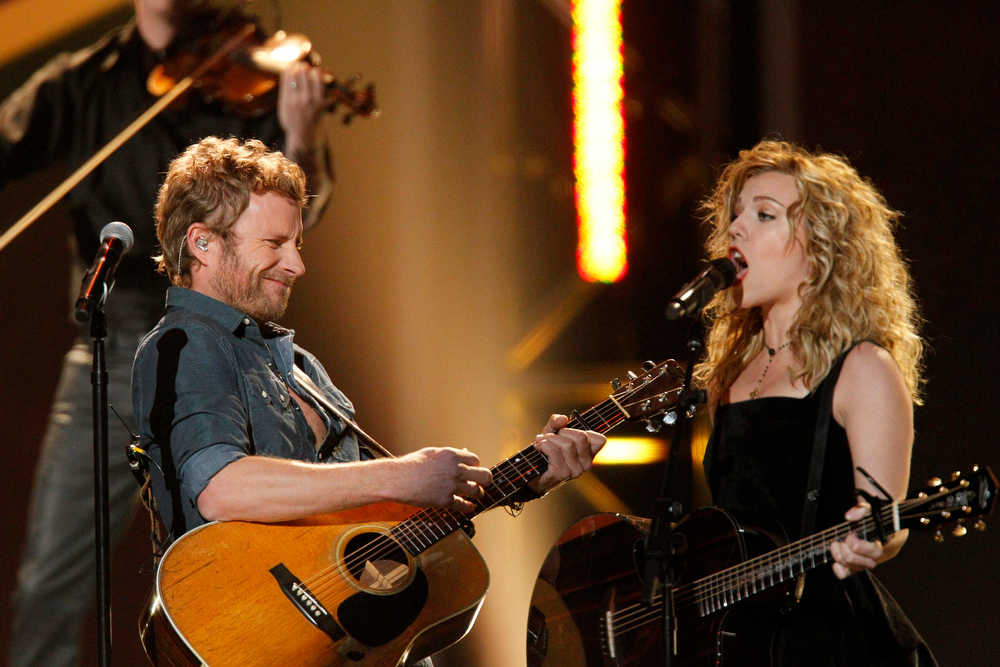 Description of . Dierks Bentley (L) performs with The Band Perry during the the Grammy Nominations Concert in Nashville, Tennessee December 5, 2012. REUTERS/Harrison McClary