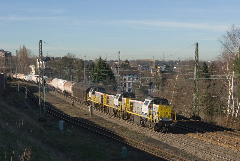 During 2008 B-Cargo was operating trains starting and terminating in Gremberg with multiple-unit lashups of class 77 diesels, by way of Welkenraedt and Aachen. Here 7787, 7860, and 7776 bring FE 44521 through Eschweiler eastbound.