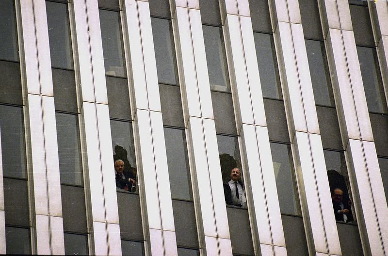 . Workers peer through broken windows of the World Trade Center in New York on Feb. 26, 1993, after an explosion in an underground garage rocked the twin towers complex.  Heavy smoke, caused by underground fires, was reported throughout the buildings, causing the evacuation of the buildings.  (AP Photo/Alex Brandon)