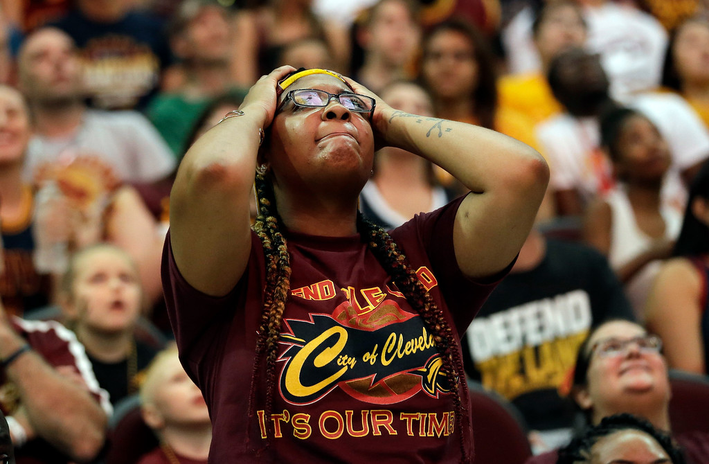 . Brittany Smith reacts during a watch party at Quicken Loans Arena during Game 5 of basketball\'s NBA Finals between the Golden State Warriors and the Cleveland Cavaliers, Monday, June 12, 2017, in Cleveland. (AP Photo/Tony Dejak)
