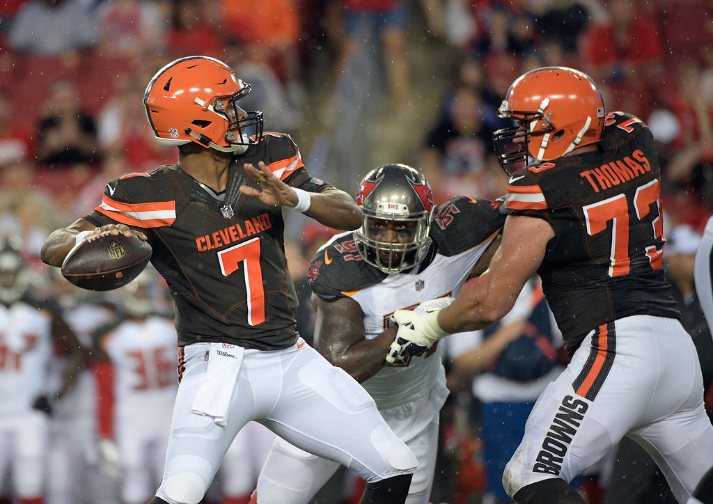 . Cleveland Browns quarterback DeShone Kizer (7) throws a pass as tackle Joe Thomas (73) blocks Tampa Bay Buccaneers defensive end Robert Ayers (91) during the XX quarter of an NFL preseason football game Saturday, Aug. 26, 2017, in Tampa, Fla. (AP Photo/Phelan Ebenhack)