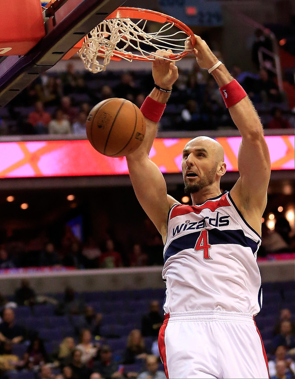 . Marcin Gortat #4 of the Washington Wizards dunks against the Denver Nuggets during the first half at Verizon Center on December 9, 2013 in Washington, DC.     (Photo by Rob Carr/Getty Images)
