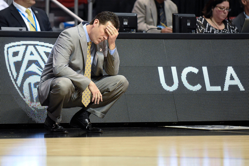 . UCLA coach Steve Alford touches his forehead after a basket by Tulsa during the first half of a second-round game in the NCAA men\'s college basketball tournament Friday, March 21, 2014, in San Diego. (AP Photo/Denis Poroy)