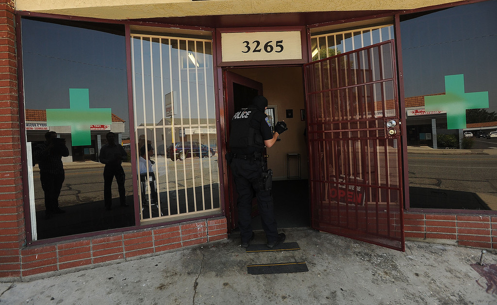 . San Bernardino Police conduct a raid at a marijuana dispensary along the 3200 block of North E Street in San Bernardino May 9, 2013. GABRIEL LUIS ACOSTA/STAFF PHOTOGRAPHER.