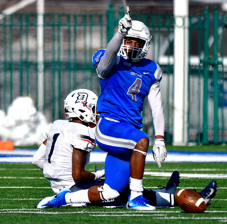 11/17/2018 Mike Orazzi | Staff CCSU's Tajik Bagley (4) after breaking up a pass meant for Duquesne's Nehari Crawford (1) at Arute Field in New Britain Saturday afternoon.