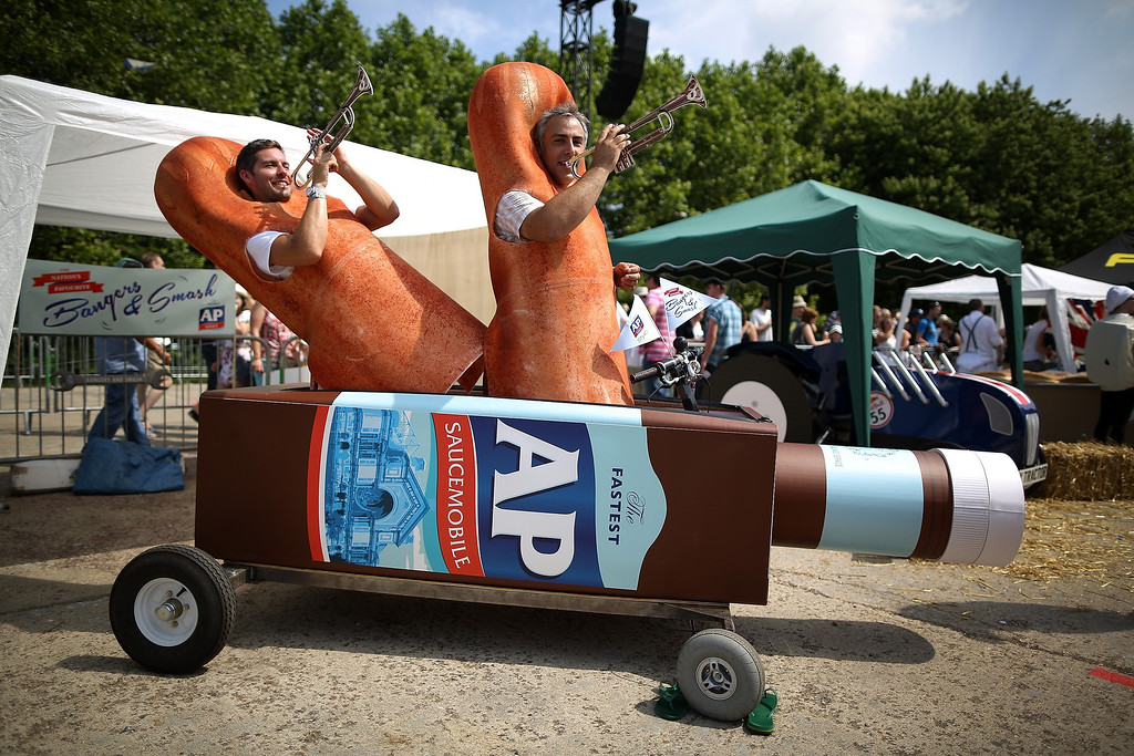 . A team in their soapbox racer plays instruments ahead of the start of the races at Alexandra Palace on July 14, 2013 in London, England. The Red Bull Soapbox Race returned to London after nine years and encourages competitors to build and race their own homemade soapboxes down a hill.  (Photo by Jordan Mansfield/Getty Images)