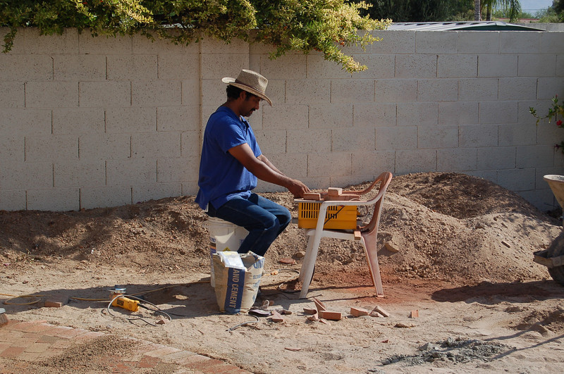 Guillermo's cousin cutting brick.