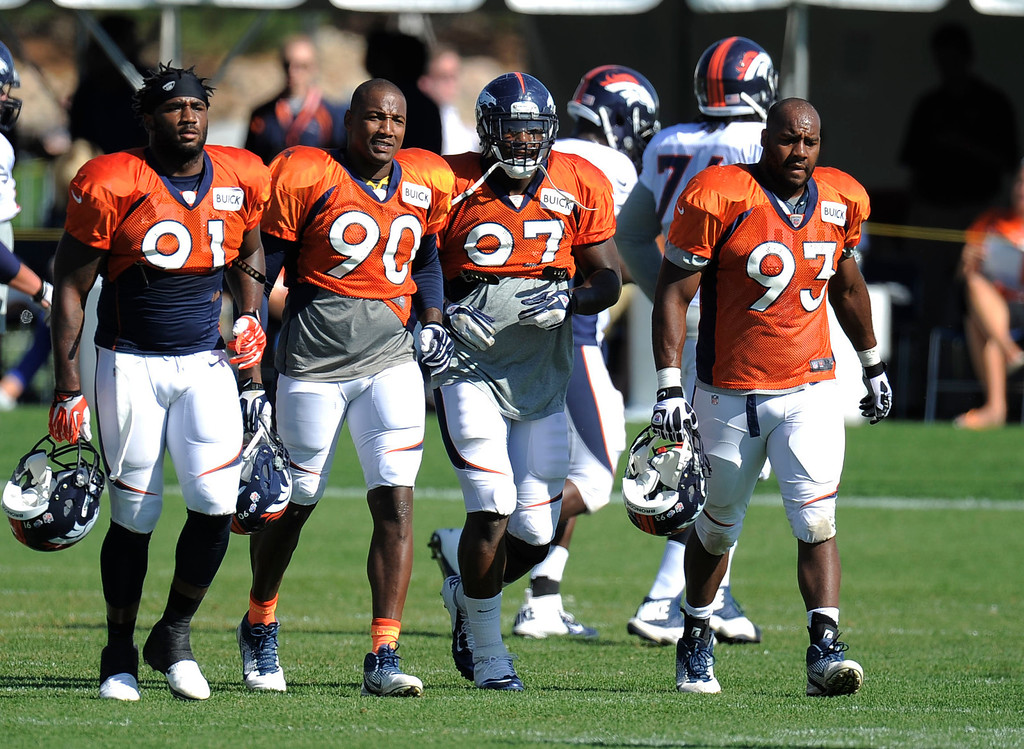 . Denver Broncos Robert Ayres (91) Shaun Phillips (90) Malik Jackson (97) and Jeremy Beal (93) head to drills during training camp August 13, 2013 at Dove Valley. (Photo By John Leyba/The Denver Post)