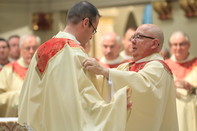 Fr. James Kirk helps Richard Jasper with his vestments during his Ordination at Cathedral of Saint Peter Church, Saturday, May 20, 2017. wwwDonBlakePhotography.com