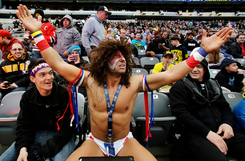 . Fan Chris Sladic, of the Bronx borough of New York, waits for the start of the WWE Wrestlemania 29 wrestling event, Sunday, April 7, 2013, in East Rutherford, N.J. Sladic said he has waited all his life for this. (AP Photo/Mel Evans)