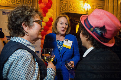 Outstanding Voices recipient Jenny Durkan (center), a partner at Quinn Emanuel Urquhart & Sullivan LLP, speaks with other attendees at the Puget Sound Business Journal's The Business Of Pride event at the Paramount Theatre in Seattle on Thursday, May 26, 2016. (BUSINESS JOURNAL PHOTO | Dan DeLong)