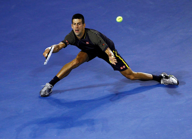 . Novak Djokovic of Serbia hits a return to Andy Murray of Britain during their men\'s singles final match at the Australian Open tennis tournament in Melbourne, January 27, 2013.             REUTERS/Navesh Chitrakar