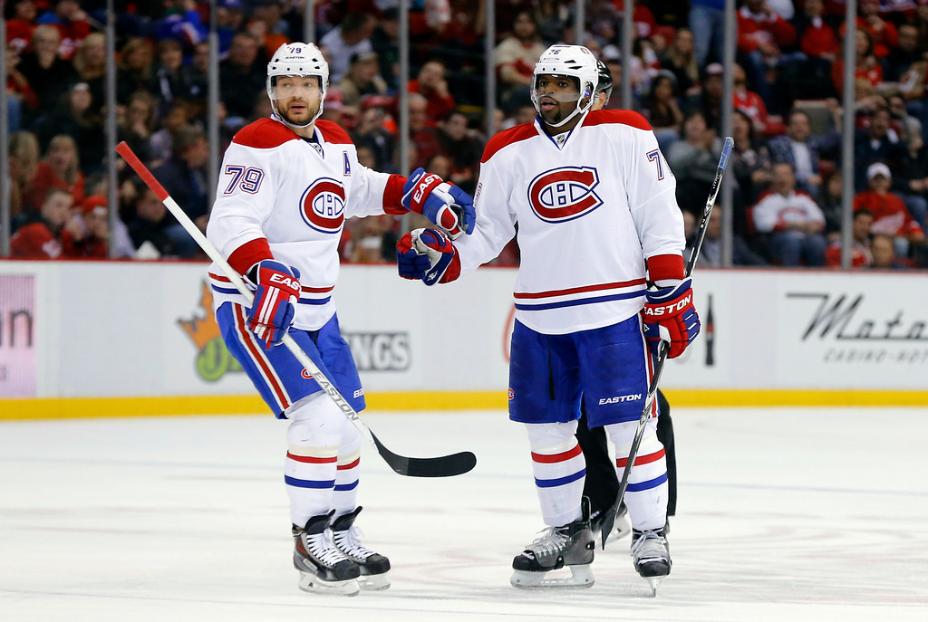 . Montreal Canadiens defenseman P.K. Subban (76) celebrates his goal with defenseman Andrei Markov (79) in the second period of an NHL hockey game in Detroit Sunday, Nov. 16, 2014. (AP Photo/Paul Sancya)